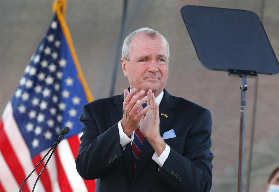 FILE- In this Aug. 25, 2020 file photo, New Jersey Gov. Phil Murphy speaks during his 2021 budget address at SHI Stadium at Rutgers University in Piscataway, NJ. Murphy says he and fellow Democratic legislative leaders have agreed to raise income taxes on millionaires, Thursday, Sept. 17, while also giving about 800,000 families a $500 tax rebate.. (AP Photo/Noah K. Murray, File)
