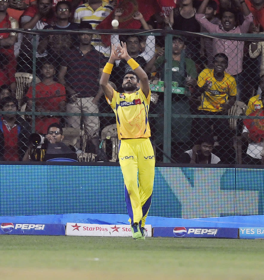 Ravindra Jadeja of Chennai Super Kings takes a catch to get the wicket of AB De Villiers of Royal Challengers Bangalore during match 70 of the Pepsi Indian Premier League between The Royal Challengers Bangalore and The Chennai Superkings held at the M. Chinnaswamy Stadium, Bengaluru  on the 18th May 2013. (BCCI)