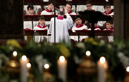 The choir of Sistine Chapel is seen before the arrival of Pope Francis to lead the Feast of the Presentation of the Lord mass in Saint Peter's Basilica at the Vatican