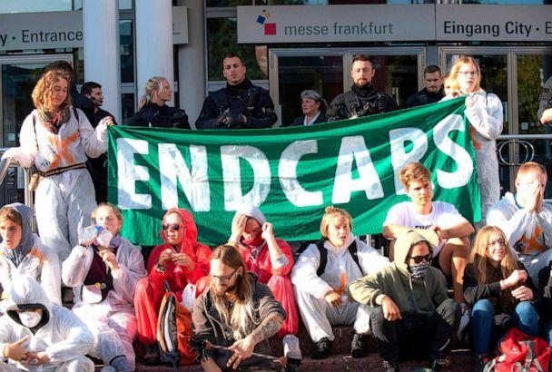 PHOTO: Demonstrators from the action group 'Sand im Getriebe' (grit in the gears) are calling for change in transport policy, Sept. 15, 2019, outside the fairgrounds in Frankfurt am Main, western German (Boris Roessler/AFP/Getty Images)