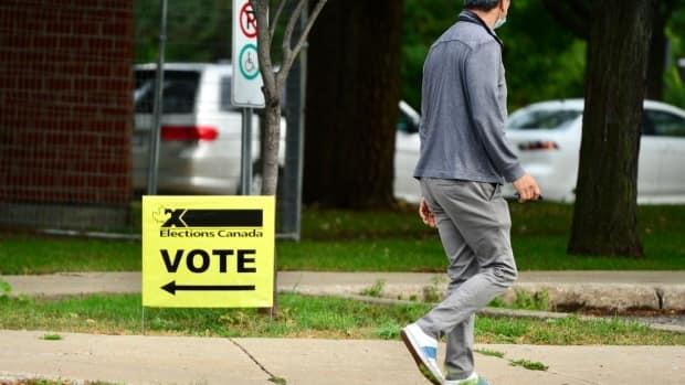 A man walks near an advance polling station in La Prairie, Que., a suburb of Montreal, on Sept. 10, 2021.  (Jean-Claude Taliana/CBC/Radio-Canada - image credit)