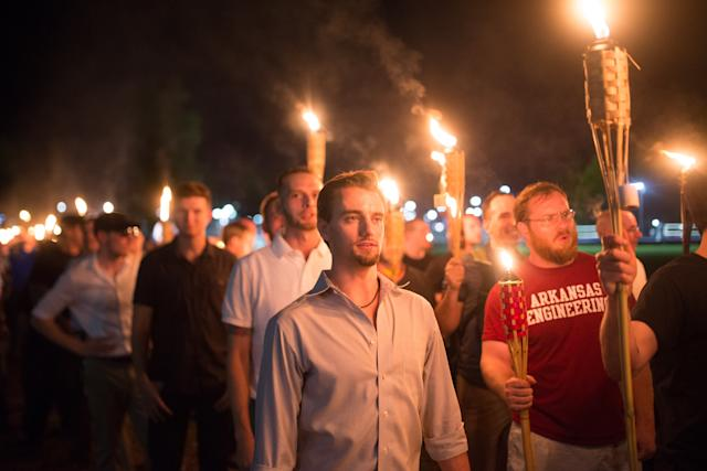 """White supremacists march with tiki torches through the University of Virginia campus the night before the """"Unite the Right"""" rally in Charlottesville. (Zach D Roberts/NurPhoto via Getty Images)"""
