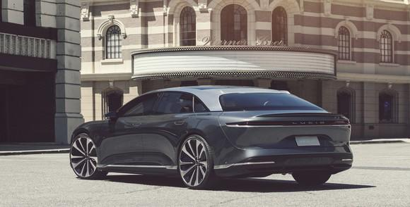 A gray Lucid Air, a sleek and low-slung full-size sedan.