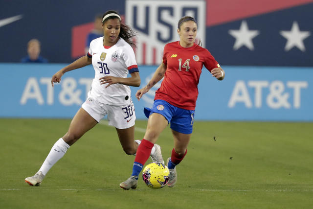 Costa Rica forward Priscilla Chinchilla (14) moves the ball past U.S. forward Margaret Purce (30) during the first half of an international friendly soccer match Sunday, Nov. 10, 2019, in Jacksonville, Fla. (AP Photo/John Raoux)