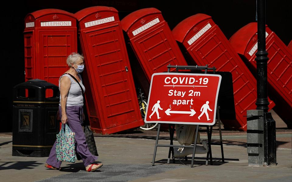 Social distancing restrictions should no longer be part of the UK picture after June, the letter says - Matt Dunham/AP