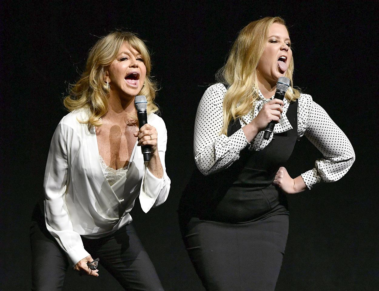 <p>Goldie Hawn and Amy Schumer get animated at a Fox presentation during CinemaCon on Thursday in Las Vegas.</p>