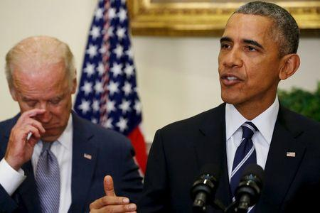Obama, flanked by Biden, delivers a statement on the Keystone XL pipeline at the White House in Washington