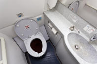 Cabin lavatory/toilet in modern airplane. (Getty)