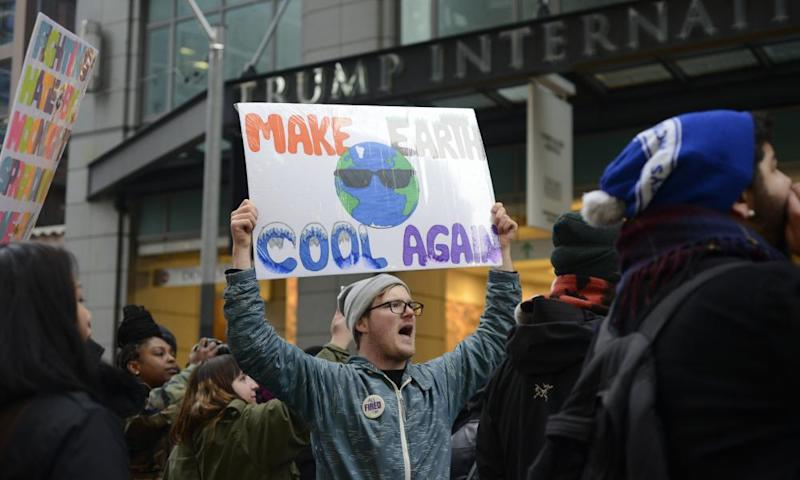 A protester denounces Donald Trump's climate policy.