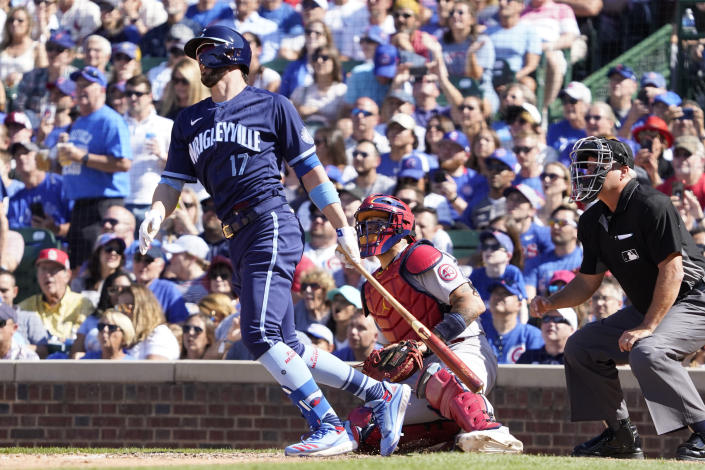 Chicago Cubs' Kris Bryant (17) watches his three-run double against the St. Louis Cardinals during the seventh inning of a baseball game, Friday, July 9, 2021, in Chicago. (AP Photo/David Banks)