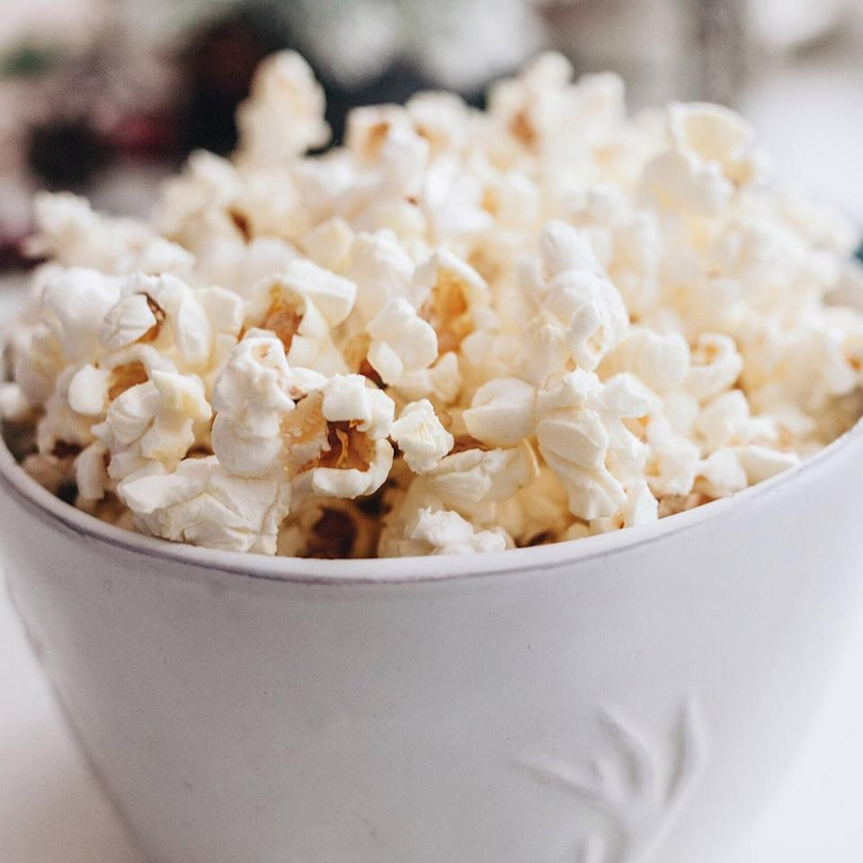 "<p>With the right toppings, popcorn makes the perfect salty-sweet treat. ""You can put plain popcorn kernels in a bag and pop them in the microwave, and then while it's hot you can top them with different things,"" says <a rel=""nofollow"" href=""https://www.instagram.com/bonnietaubdix/"">Bonnie Taub-Dix</a>, R.D.N., creator of <a rel=""nofollow"" href=""https://bonnietaubdix.com"">Better Than Dieting</a> and author of <a rel=""nofollow"" href=""https://www.amazon.com/Read-Before-You-Eat-Taking/dp/1979739722/ref=sr_1_1?s=books&ie=UTF8&qid=1513656967&sr=1-1&keywords=read+it+before+you+eat+it""><em>Read It Before You Eat It: Taking You From Label to Table</em></a>. ""If you like sweetness, you can add dark chocolate chips or shavings.""</p>"