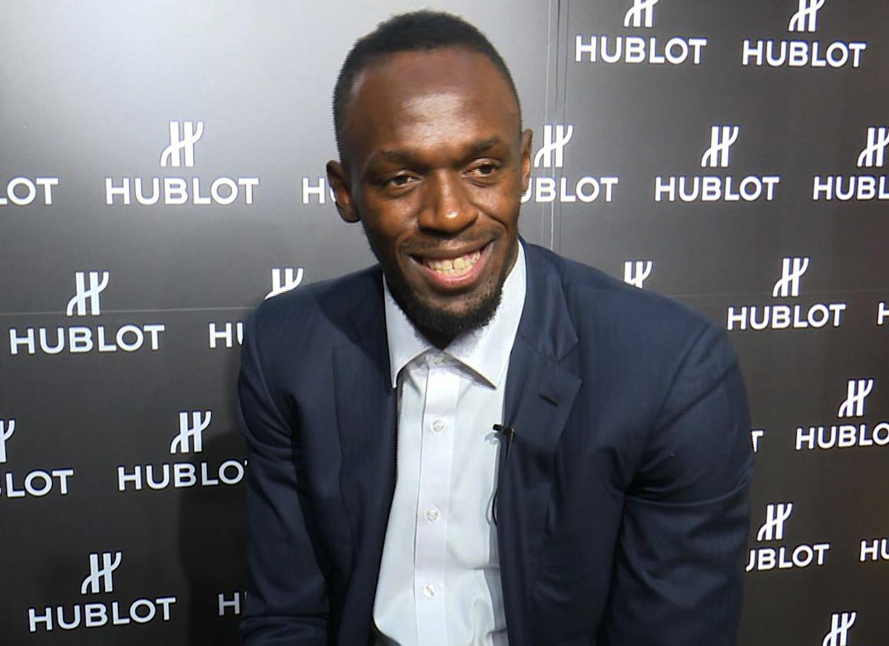 In this image made from video, Usain Bolt of Jamaica speaks during an interview in Kyoto, western Japan, Tuesday, Sept. 5, 2017. Bolt is feeling no pressure in retirement, confident his best times can remain world records for decades. The only sprinter to capture the 100- and 200-meter track titles at three consecutive Olympics, Bolt retired last month after the world championships in London. He holds the world record of 9.58 seconds in the 100 and 19.19 in the 200 — both set in Berlin in 2009. (AP Video via AP)