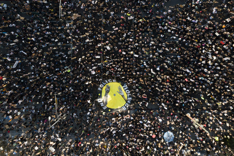 Large protest in Los Angeles, seen from above.