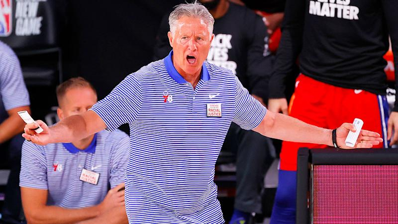 Seen here, 76ers coach Brett Brown appeals a decision during an NBA game.