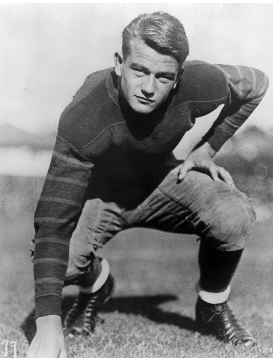 """<p>John Wayne got into the University of Southern California for a <a href=""""https://news.usc.edu/15621/john-wayne-an-american-icon/"""" rel=""""nofollow noopener"""" target=""""_blank"""" data-ylk=""""slk:football scholarship in 1925"""" class=""""link rapid-noclick-resp"""">football scholarship in 1925</a>. Unfortunately, the future Western movie star broke his collarbone surfing and lost his scholarship at the beginning of his junior year. </p>"""