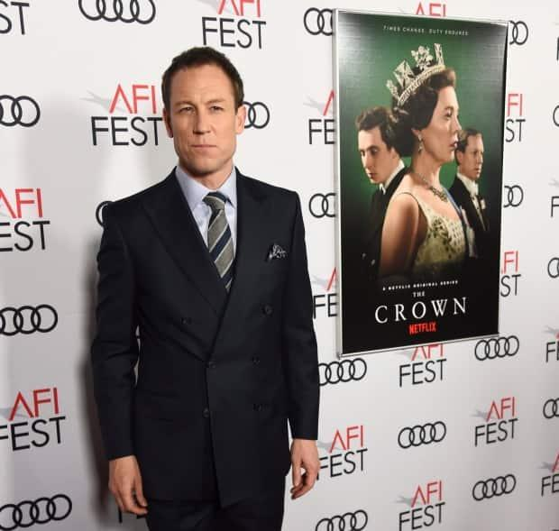 Tobias Menzies strikes a pose for the cameras at a gala screening of The Crown at  the 2019 AFI Fest at the TCL Chinese Theatre on Nov. 16, 2019, in Los Angeles.