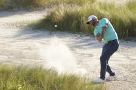 Dustin Johnson hits out of the bunker on the 16 hole during the first round of the PGA Championship golf tournament on the Ocean Course Thursday, May 20, 2021, in Kiawah Island, S.C. (AP Photo/Chris Carlson)
