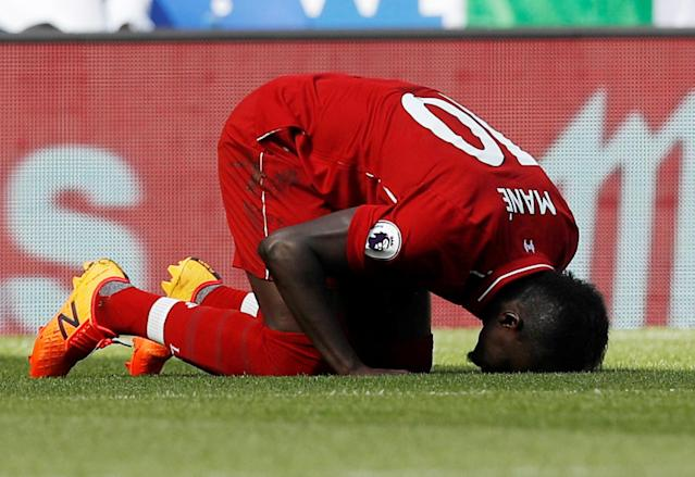 Sadio Mane celebrates his goals by praying