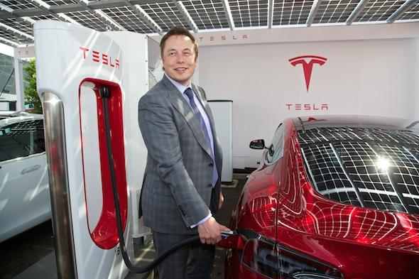 LONDON, ENGLAND - Saturday, June 7, 2014: CEO & Chief Product Architect Elon Musk plugs in a Supercharger to a right-hand drive Model S at the UK launch of Tesla Motors' Model S electric car at the Crystal. (Pic by David Rawcliffe/Propaganda)