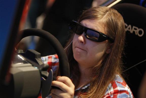 A visitor plays a Playstation during the Gamescom 2012 fair in Cologne August 16, 2012.
