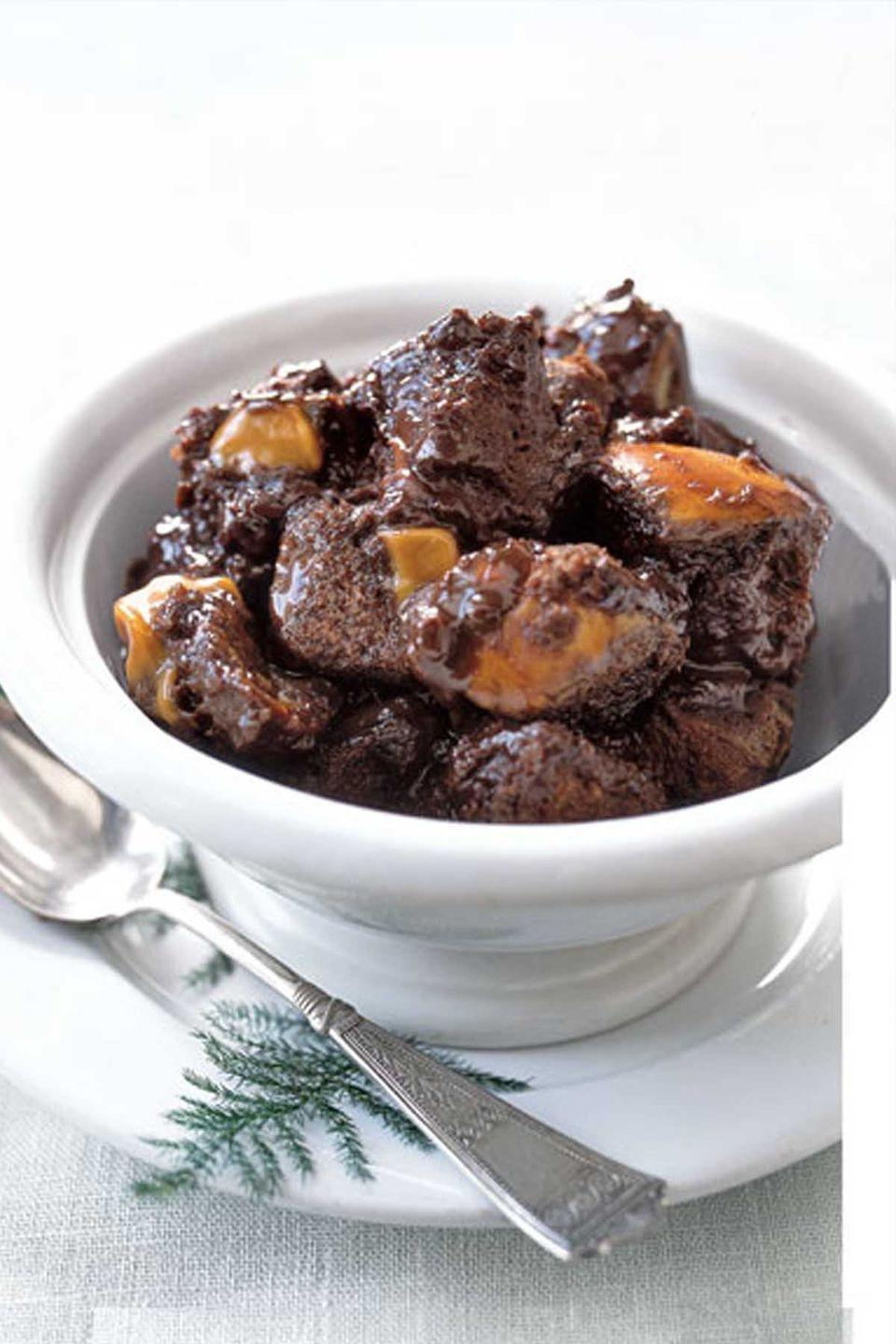 "<p>Melted caramel coats this chocolate-chip challah-bread pudding, served warm.</p><p><strong><a href=""https://www.countryliving.com/food-drinks/recipes/a1136/chocolate-caramel-bread-pudding-3243/"" rel=""nofollow noopener"" target=""_blank"" data-ylk=""slk:Get the recipe"" class=""link rapid-noclick-resp"">Get the recipe</a>.</strong></p><p><a class=""link rapid-noclick-resp"" href=""https://www.amazon.com/Premium-Stainless-Steel-Mixing-Brushed/dp/B01HTYH8YA/?tag=syn-yahoo-20&ascsubtag=%5Bartid%7C10050.g.1138%5Bsrc%7Cyahoo-us"" rel=""nofollow noopener"" target=""_blank"" data-ylk=""slk:SHOP MIXING BOWLS"">SHOP MIXING BOWLS</a></p>"
