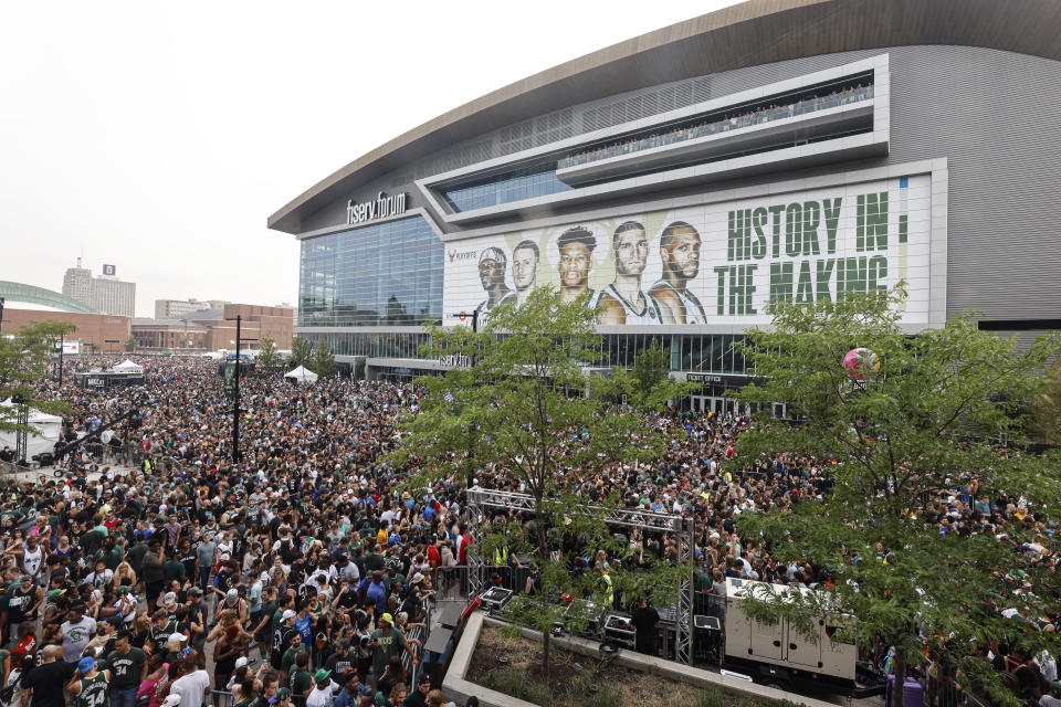 Fans make their way into the Deer District before Game 6 of the NBA Finals in Milwaukee