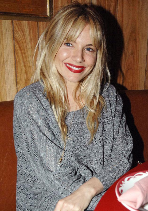 Celebrities wearing red lipstick: Sienna Miller opts for minimal make-up with her pout.<br><br>[Rex]