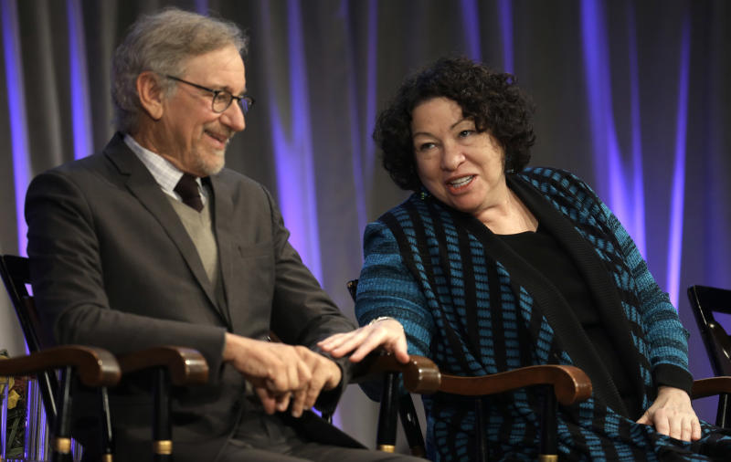 Supreme Court Justice Sonia Sotomayor, right, speaks with film director Steven Spielberg, left, on stage during award ceremonies for the W.E.B. Du Bois Medal winners, on the campus of Harvard University, in Cambridge, Mass., Wednesday, Oct. 2, 2013. Harvard has awarded the medal since 2000 to people whose work has contributed to African and African-American culture. Sotomayor and Spielberg are among the recipients. (AP Photo/Steven Senne)