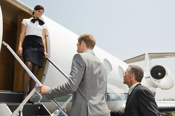 Passengers entering a business jet.