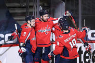 Washington Capitals right wing Tom Wilson (43) celebrates his first goal of the game with defenseman Dmitry Orlov (9) and center Nicklas Backstrom (19) during the second period of an NHL hockey game against the New York Rangers, Sunday, March 28, 2021, in Washington. (AP Photo/Nick Wass)