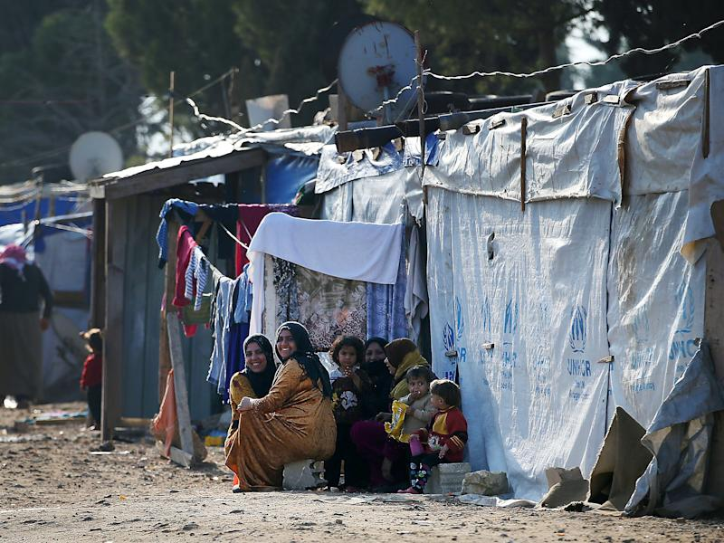 Syrian refugee women and children in a refugee camp in Lebanon, close to the Syrian border: PA Wire