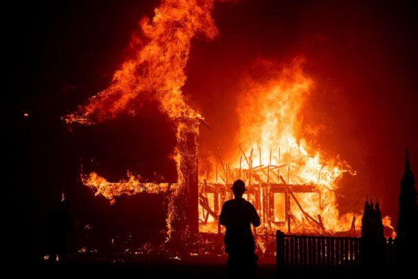 PHOTO: In this file photo taken on Nov. 8, 2018, a home burns during a wildfire in Paradise, California. (AP Photo/Noah Berger, File)