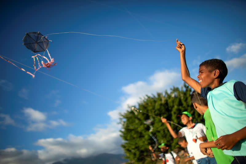 Children fly kites as the Petare neighbourhood celebrates the 400th anniversary of its founding, in Caracas