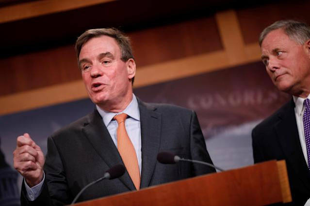 Sen. Mark Warner, D-Va., with Sen. Richard Burr, R-N.C. at the Capitol on Oct. 4, gives an update on the investigation into Russian involvement in the 2016 election. (Photo: Aaron P. Bernstein/Reuters)