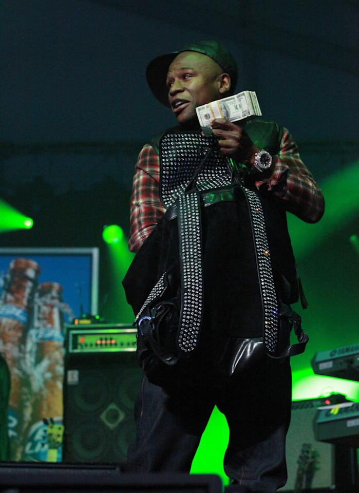 Floyd Mayweather flashes cash on stage during 50 Cent's performance at the Bud Light Hotel concert.