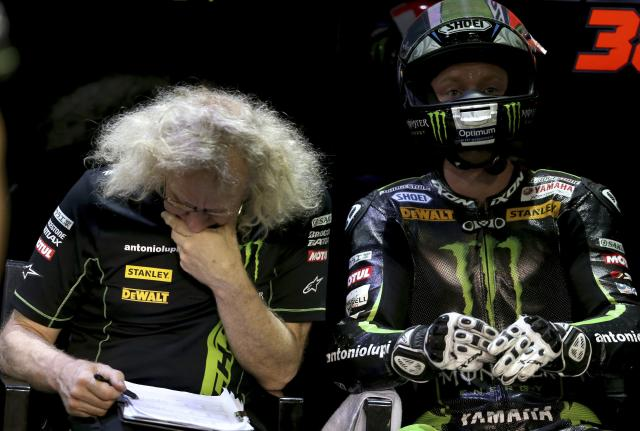 Monster Yamaha Tech 3 Bradley Smith (R) of Britain looks on in his box during a free practice session at the MotoGP World Championship at the Losail International circuit in Doha March 21, 2014. REUTERS/Fadi Al-Assaad (QATAR - Tags: SPORT MOTORSPORT)