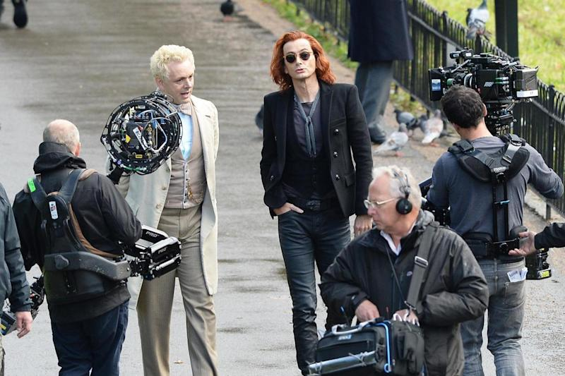 Filming: Michael Sheen and David Tennant in costume on the set of Good Omens (PA)