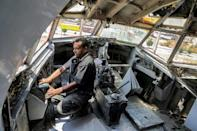 A technician drills holes in the cockpit of Boeing 707 aircraft, which the brothers say will be a great place for newly-weds later