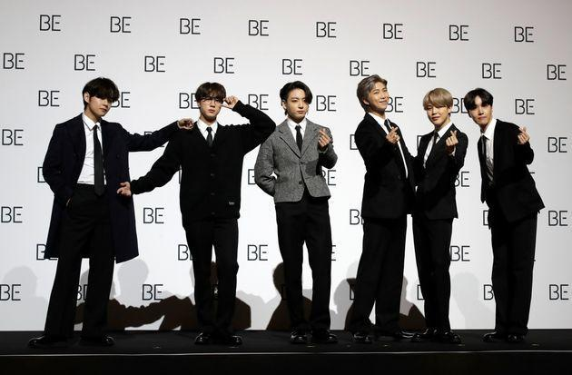 File---File photo taken Nov.20, 2020 members of South Korean K-pop band BTS pose for photographers during a press conference to introduce their new album