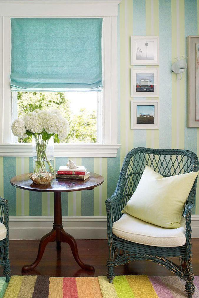 """<p>In a guest room, a green and aqua striped Robert Hoven wall treatment complements a rainbow striped Doug and Gene Meyer rug. The 1920s wicker chairs are original to the house, and the 19th-century table is American.<br><em><br>Ombrello Green Stripe Wallpaper, $1.25/sq. ft. <br></em><a class=""""link rapid-noclick-resp"""" href=""""https://www.wallpaperwarehouse.com/product-details/Ombrello-Green-Stripe-3113-010335-Brewster-Wallpaper-3113-010335/1488042517FATMUNVJ?gclid=CjwKCAjw8NfrBRA7EiwAfiVJpZiliB9g2thS641we7NUCHyr9Bxah_Lxlt-J22XJwIEGu1B7ZZEbYBoC63kQAvD_BwE"""" rel=""""nofollow noopener"""" target=""""_blank"""" data-ylk=""""slk:Shop the Look"""">Shop the Look</a></p>"""