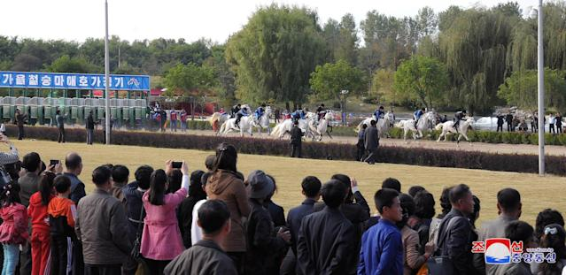 People watch a horse riding game at the Mirim Equestrian Riding Club in Pyongyang, North Korea October 15, 2017, in this picture released by North Korea's Korean Central News Agency (KCNA) in Pyongyang. KCNA/via REUTERS ATTENTION EDITORS - THIS IMAGE WAS PROVIDED BY A THIRD PARTY. REUTERS IS UNABLE TO INDEPENDENTLY VERIFY THIS IMAGE. NO THIRD PARTY SALES. SOUTH KOREA OUT.