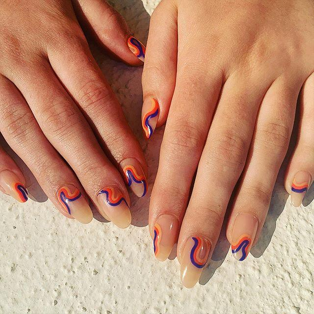 """<p>60s nail art doesn't have to be OTT. Go for graphic waves on bare nails for a groovy take on negative space nails.</p><p><a href=""""https://www.instagram.com/p/CDedlDvD9Ta/?utm_source=ig_embed&utm_campaign=loading"""">See the original post on Instagram</a></p>"""