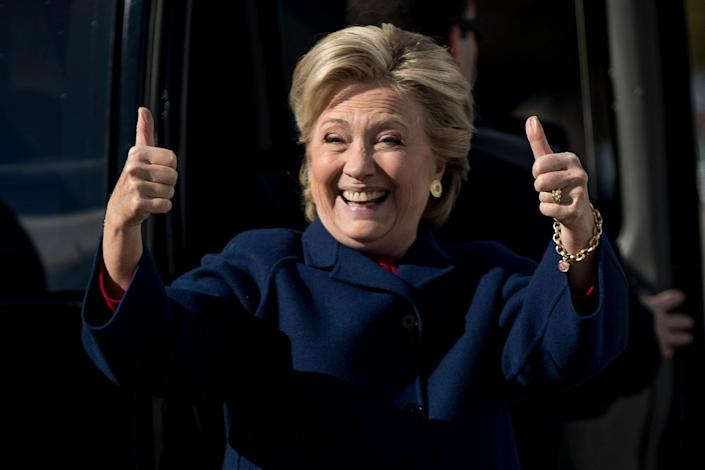 <p>Hillary Clinton gives two thumbs up to a member of the media as she arrives to board her campaign plane at Westchester County Airport in White Plains, N.Y., Tuesday, Oct. 25, 2016, to travel to Ft. Lauderdale, Fla. for a rally. (AP Photo/Andrew Harnik) </p>