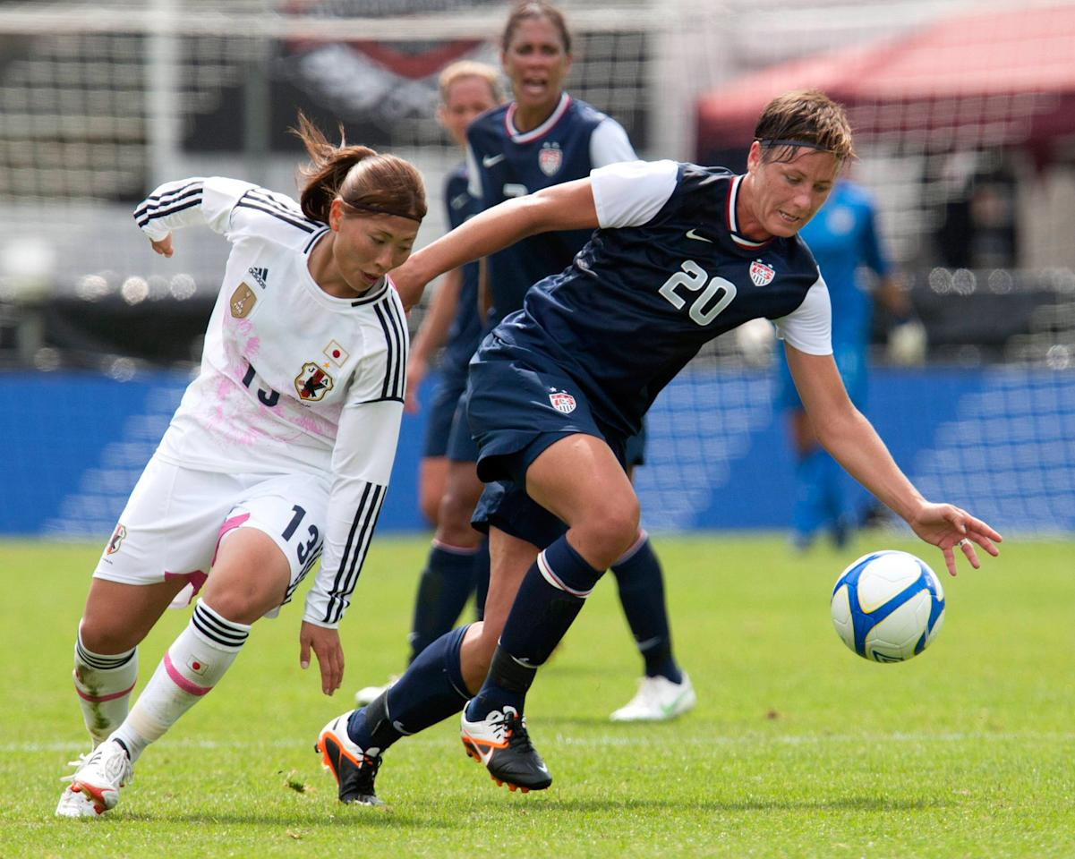 HALMSTAD, SWEDEN - JUNE 18: Abby Wambach USA (R) vies against Rumi Utsugi of Japan during the Swedish Invitational Women's Volvo Cup match between Japan and USA on June 18, 2012 in Halmstad, Sweden. (Photo by Berndt Wennebrink/Getty Images)