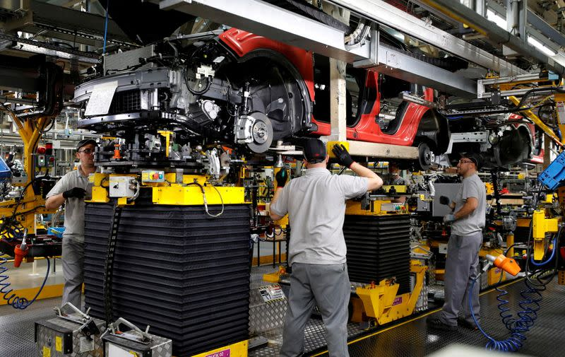 FILE PHOTO: Workers are seen on the production line at Nissan's car plant in Sunderland, Britain