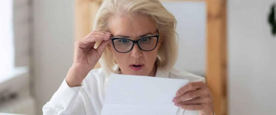 A woman looks with surprise at her low health insurance bill.