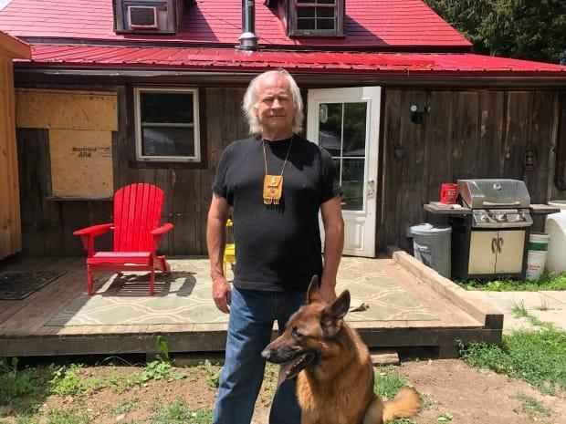 Former Toronto police officer Ralph Thistle has been living in a cabin  with no running water, awaiting payment from Ontario's Workplace Safety and Insurance Board. (Greg Bruce/CBC - image credit)