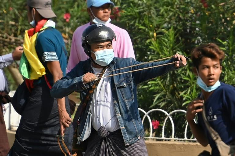 Some people brought slingshots to the rally in Yangon