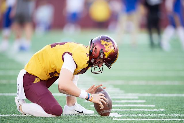 Casey O'Brien #14 of the Minnesota Gophers warms up before the game against the South Dakota State Jackrabbits. (Photo by Hannah Foslien/Getty Images)