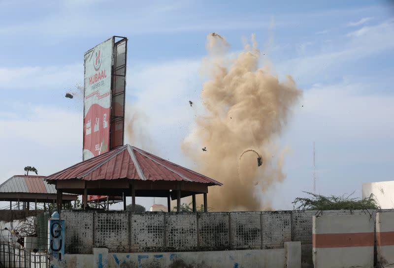 Somali security forces detonate a controlled explosion at the SYL hotel after taking it over from Al Shabaab gunmen, who lunched an attack on the hotel near the presidential residence in Mogadishu